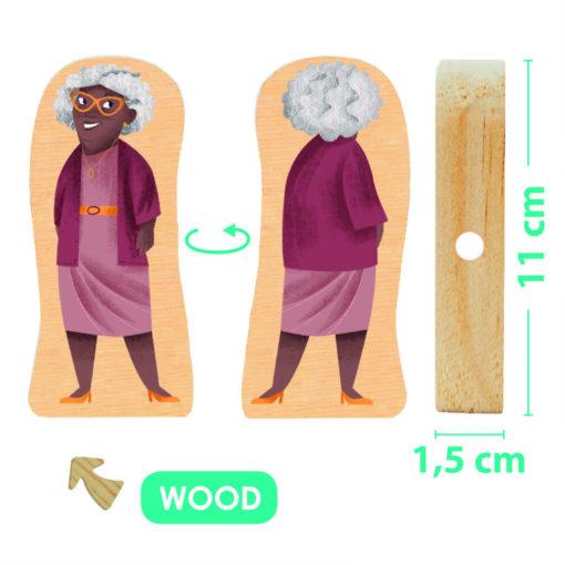 Abbildung einer der Figuren aus Holz. Alte Schwarze Frau mit grauen Haaren, stylischer oranger Brille und Fliederfarbenem Kostüm. Maße: 11 cm hoch, 1,5 cm breite Standfläche.