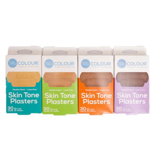 Verpackungen von Pflastern in 4 verschiedenen Hautfarben von beige bis dunkelbraun
