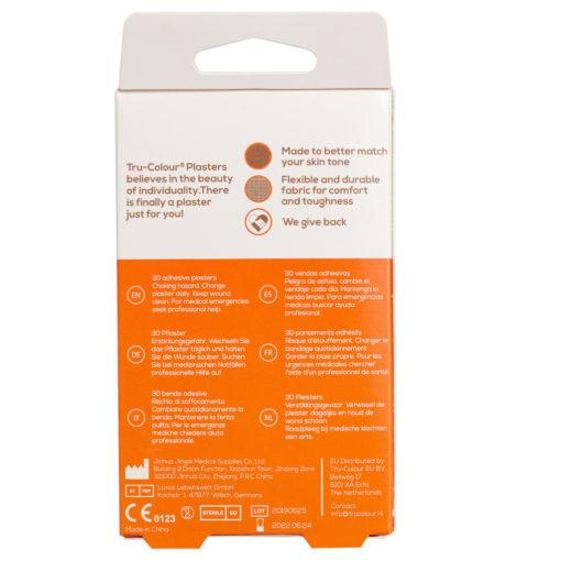 Pflaster in mittelbraun dunkle Hautfarbe. Orange Verpackung, Rückseite