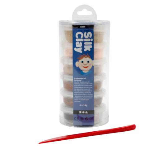6 kleine Döschen mit Knete in Hautfarben von beige bis dunkelbraun in Umverpackung und rotem Modellierspatel