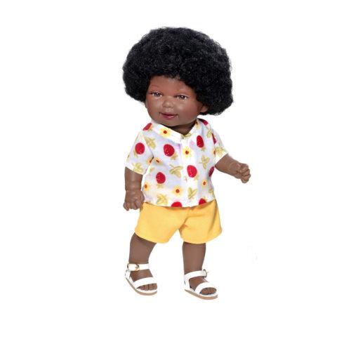 Schwarze Puppe (mit brauner Hautfarbe) und großem Afro. Gemusterte weiße Bluse, gelbe Shorts und weiße Sandalen. Fester Körper